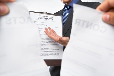 Businessman offering new contract when the old contract being torn out Stock Photo - 7283829