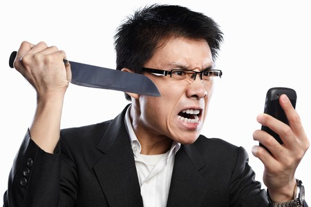 Chinese businessman expression and using knife when using video call, isolated on white background photo