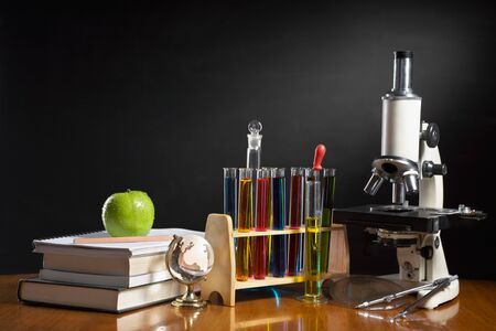 School concept with item represent each subject in school, biology, geography, mathematics, chemistry, literature, etc photo