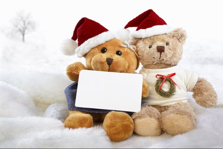 Christmas teddy bear dolls holding blank paper photo