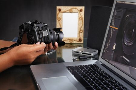 Photographer's hand preparing her/his camera before assignment Stock Photo - 7858053