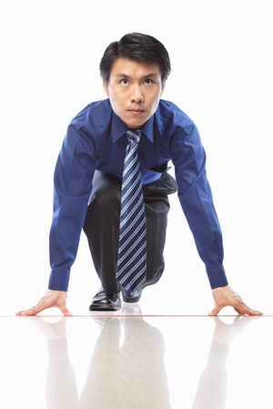 running businessman: Asian businessman start to run, on isolatd background Stock Photo