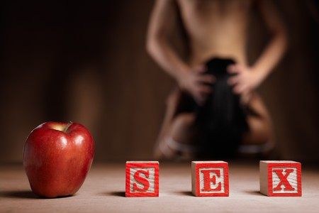 sex couple: Red apple, and word SX with people doing sex activity on background