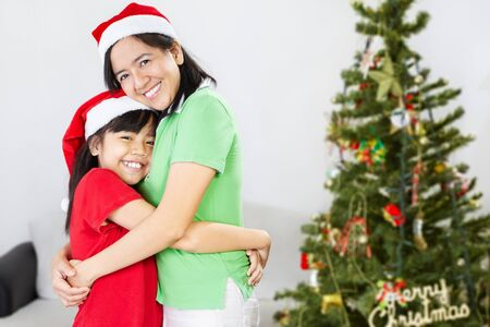 Asian mother and daughter on Christmas, hug each other photo