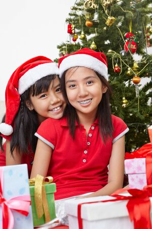 Two Lovely Asian sibling with Christmas outfit photo