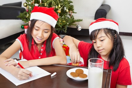 Kids busy preparing letter to Santa for their wishes photo