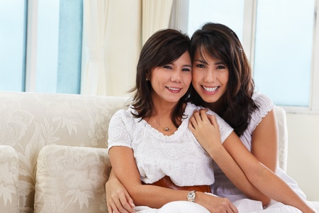 Happy pose of mother and daughter in their home. photo