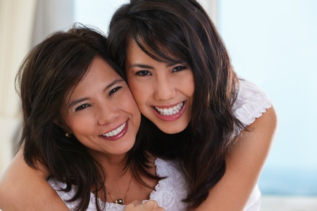 asian mother and daughter: Happy pose of mother and daughter in their home.
