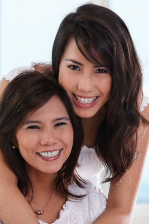 Happy pose of mother and daughter in their home.