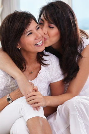 Young Asian female  kiss her mother photo