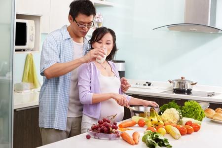 Pregnant wife drinking milk