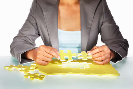 jigsaw puzzle: Unrecognizable Businesswoman trying to solve the puzzle