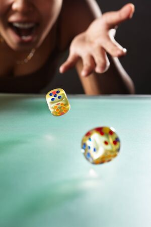 rolling dice: Young Asian woman throwing the dices for gambling