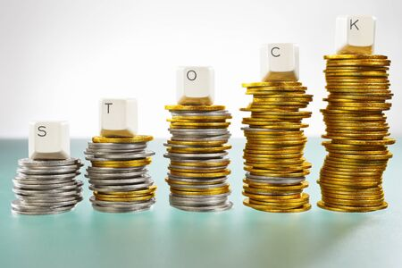 STOCK word over graph like  coin stacks shapes inclining graph Stock Photo - 9113100