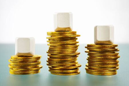 Three blank block over stack of gold coins Stock Photo - 9112990