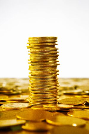 Gold coins stack over scater coins Stock Photo - 9112843