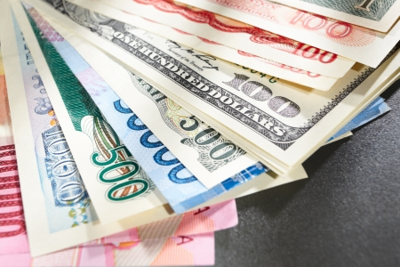 foreign currency: Money from different countries, arranged overlap of each other Stock Photo