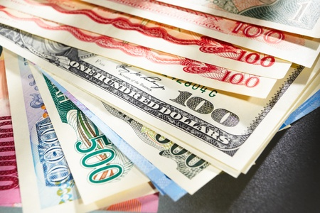 Money from different countries, arranged overlap of each other Stock Photo - 9113090