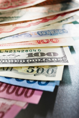Money from different countries, arranged overlap of each other Standard-Bild