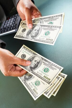 Busineswoman hand counting US dollar bills, taken close up Stock Photo - 9113138