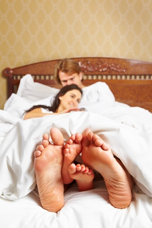 Couple sharing their moments in bed together after wake up photo