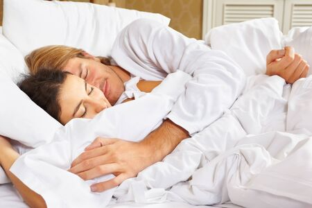 Happy couple showing their romance on fully covered white bed Stock Photo - 9553317