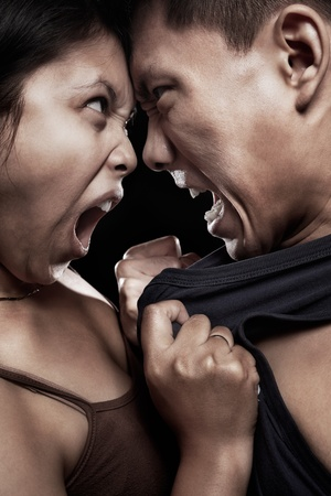 hatred: Asian couple having quarrel with physical contact