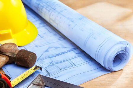 Blueprint of house design on wooden desk wth working tools Banco de Imagens