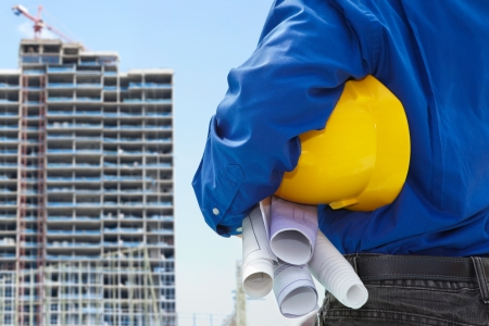 Male contractor or civil engineer looking at the bulding project on progress Stock Photo - 10010317