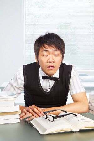 Chinese college male student awake in classroom Stock Photo - 10178324