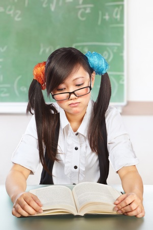 Ner Chinese female student in classroom doing stupid pose photo