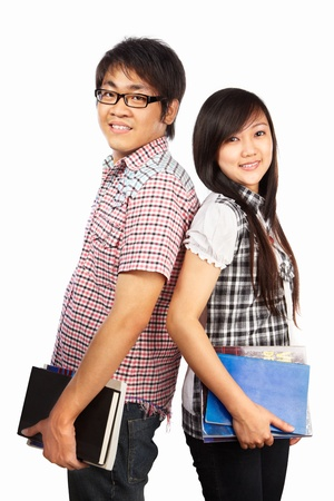 Chinese male and female students holding book, isolated on white background photo