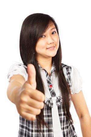 Chinese female with thumb up, isolated on white background photo