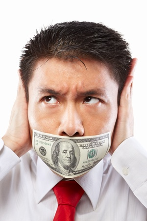 bribe: Chinese young man with his mouth sealed by a hundred dollar bills for bribe concept Stock Photo