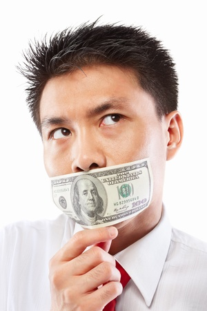 man face close up: Chinese young man with his mouth sealed by a hundred dollar bills for bribe concept Stock Photo