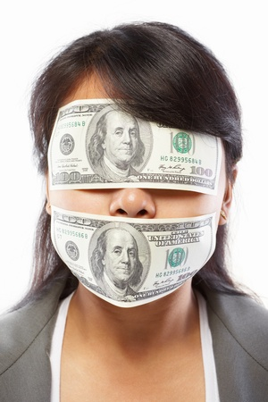 mouth closed: Asian businesswoman with eyes and mouth closed with 100 dollar bill