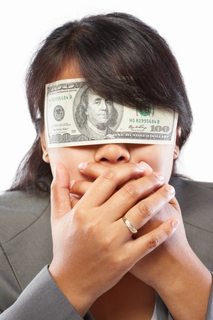 bribe: Asian businesswoman with eyes closed with 100 dollar bill Stock Photo