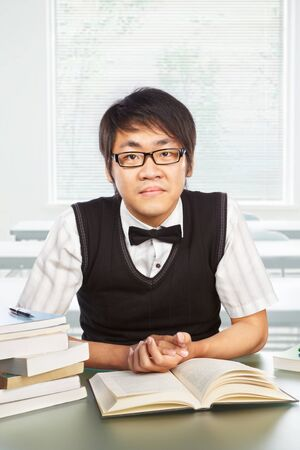 Chinese collage male student pose to the camera Stock Photo