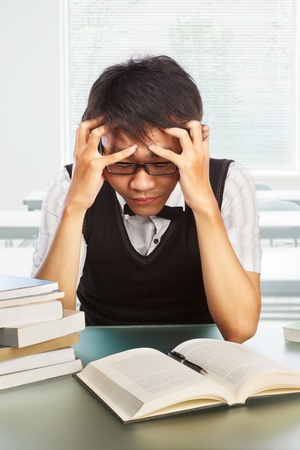 Chinese college male student look so depressed and stressful photo