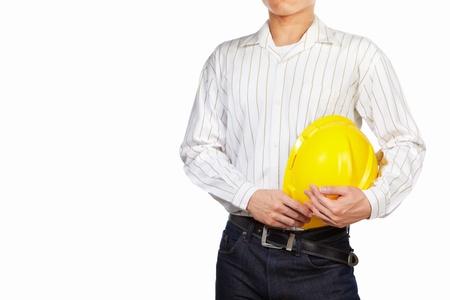 ingeniero civil: Parte del cuerpo masculino ingeniero civil con casco amarillo aislada sobre fondo blanco