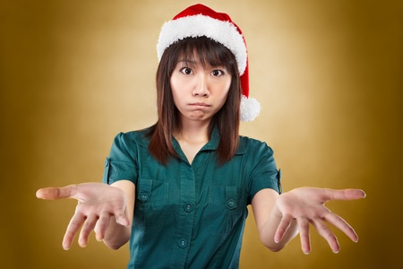 no idea: asian lady with santa hat expressing that she has no idea