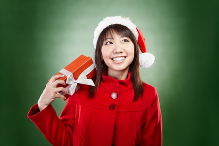 imagining: Asian lady with red Christmas outfit holding a present