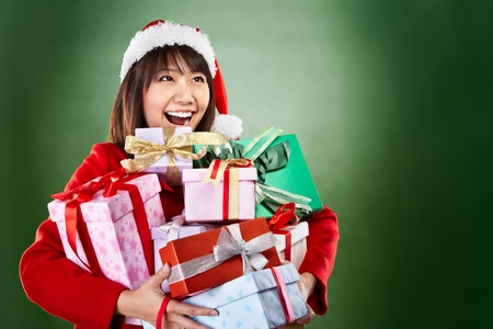 Asian lady with red Christmas outfit carrying lots of presents photo