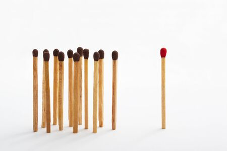 majority: Red tip matches standing alone and on the other side a group of brown tip matches