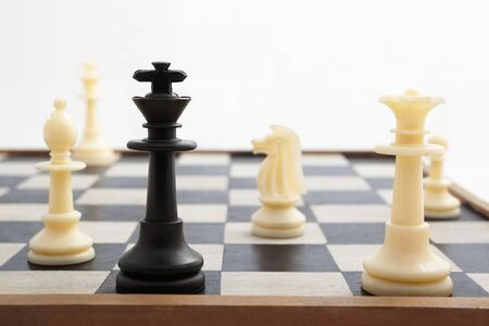 mated: Black king pieces is check mated by white pieces Stock Photo