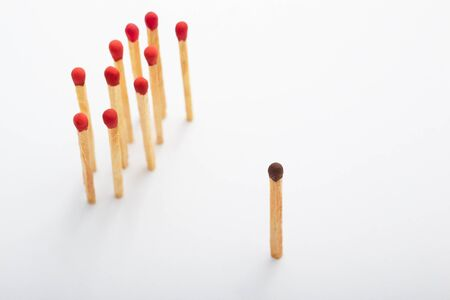 majority: Brown tip matches standing alone and on the other side a group of red tip matches