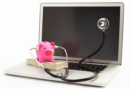 Pink piggy bank using stethoscope checking on the laptop over white background photo