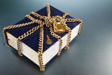hard cover: A hard cover book being chained and locked Stock Photo