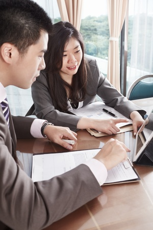 asian working woman: Two business people working together in the office
