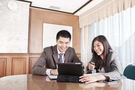 Two business people working together in the office Stock Photo - 12751330